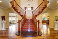 Elegant double staircase with a chandelier. Royalty Free Stock Photo