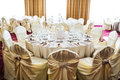 Elegant event setting with beige tablecloth set for an inside a ballroom Stock Photo