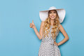 Elegant Fashion Model In Summer Dress And Sun Hat Is Showing Thumb Up And Smiling Royalty Free Stock Photo