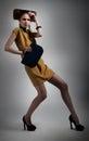 Elegant fashionable artistic girl in studio posing