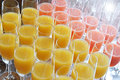 Elegant flutes of fresh orange juice and fruit displayed on a buffet table at a celebration function or catered event Stock Photo