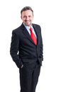 Elegant and formal business man standing wearing black suit blue shirt red tie Royalty Free Stock Photo