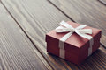 Elegant gift box on a wooden background closeup Stock Photo