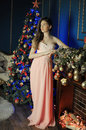 Elegant  girl in a pink long evening dress Royalty Free Stock Photo