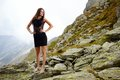 Elegant lady in dress standing on the mountain rocks high fashion young mini Stock Photo