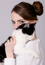 Elegant lady holding black and white cat Stock Image
