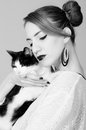 Elegant lady holding black and white cat Royalty Free Stock Photo