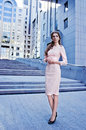 Elegant lady standing next to the office building Royalty Free Stock Photo