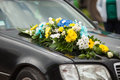 Elegant luxury black car decorated with yellow and blue flowers Royalty Free Stock Photo