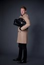 Elegant man with a hand bag wearing beige coat Royalty Free Stock Images