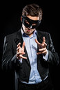Elegant man wearing black mask posing indoors Royalty Free Stock Images
