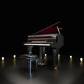 Elegant piano center stage with lighting accents on a black background room for text or copy space concert music concept Royalty Free Stock Images