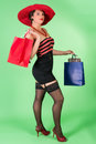 Elegant pin up woman girl with red hat and shopping bags Royalty Free Stock Photography