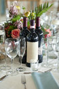 Elegant place setting with wine bottles label is blank Royalty Free Stock Photos