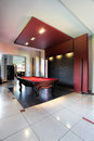 Elegant pool hall an black and red with a table Royalty Free Stock Photos