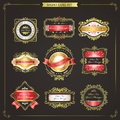 Elegant premium quality golden labels collection over black Royalty Free Stock Image
