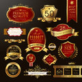 Elegant premium quality golden labels collection over black Royalty Free Stock Images