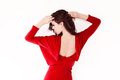 Elegant red dress woman in back view studio shot Stock Photos