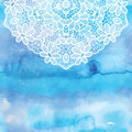 Elegant round lacy doily on watercolor background.
