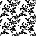 Elegant seamless pattern. Tracery of swirls and leaves on a whit Royalty Free Stock Photo
