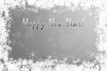 Elegant silver monochrome happy new year greeting card background with snowflakes framed white Royalty Free Stock Photo