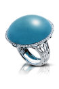 Elegant silver ring with a blue precious stone closeup reflecting on white background Stock Image