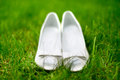 Elegant and stylish modern wedding shoes against grass in garden bridal Stock Photography