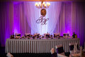 Elegant and stylish purple color wedding reception at luxury restaurant Royalty Free Stock Photo