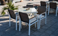 Elegant table restaurant tables with chairs placed outdoors Royalty Free Stock Image