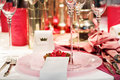 Elegant table set in soft red and pink for wedding or event part party Royalty Free Stock Photography