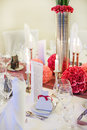 Elegant table set for wedding or event party in soft red and pi pink with paper bride groom Royalty Free Stock Photos