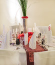 Elegant table set for wedding or event party in soft red and pi pink with paper bride groom Stock Photos