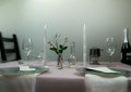 Elegant table setting. romantic dinner, wine glasses, flowers in a vase, candle Royalty Free Stock Photo