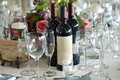 Elegant table setting with wine bottles bottle and flowers Stock Photography