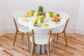 Elegant table with tasty breakfast round for three Stock Photography