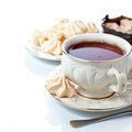 Elegant tea cup meringues isolated white Stock Photo