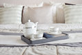 Elegant tea cup set on black tray and books in modern bedroom Royalty Free Stock Photo