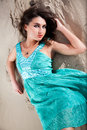 Elegant turkish woman in blue dress lying on sand dune portrait of Royalty Free Stock Photography