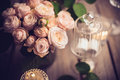 Elegant vintage wedding table decoration with roses and candles Royalty Free Stock Photo