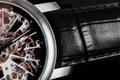 Elegant watch with visible mechanism, clockwork. Time, fashion, luxury concept. Royalty Free Stock Photo