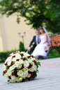 Elegant wedding bouquet with many roses on blur newlywed backgro backgrounds Royalty Free Stock Photography