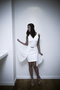 Elegant in white woman short dress and high heel shoes indoor shot Stock Photo