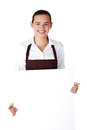 Elegant woman in apron holding blank board Stock Photo