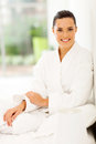 Elegant woman bathrobe young in sitting on bed at home Royalty Free Stock Image