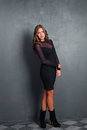 Elegant woman in black dress full body shot studio Stock Image