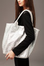 Elegant woman with a fashion bag Royalty Free Stock Photo
