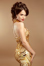 Fashion Model Girl Posing Glamour Gold Dress, Elegant Woman Gown