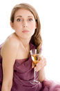 Elegant woman holding glass of champagne on white background Royalty Free Stock Photography