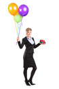 Elegant woman holding a present and balloons full length portrait of an bunch of isolated on white background Stock Photo