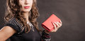 Elegant woman holding red handbag clutch bag fashion evening outfit close up leather on dark background Stock Photography
